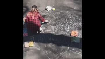 Artist creates chalk masterpiece thanking medical workers