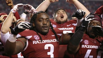 Former Razorback Alex Collins waived following arrest in Baltimore
