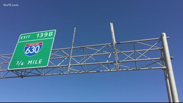 Sign falls onto I-440, causes freak accident
