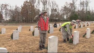 Wreaths placed on gravestones in Arkansas State Veterans Cemetary