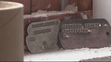 Dog tags found in Fort Smith building's wall