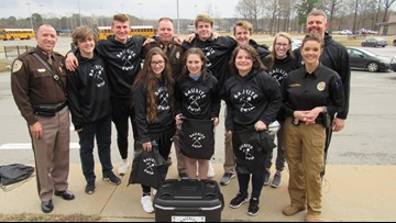 Saline County deputies buys Bauxite swim team full set of gear