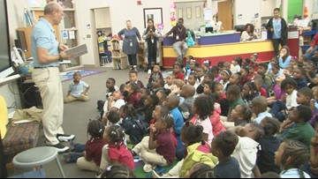 Craig reads at Stephens Elementary with his daughter to honor National Family Literacy Day
