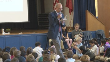 Craig O'Neill reads to Baker Elementary, the school full of future CEO's