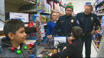 'Shop with a Cop' builds trustand brightens the holiday season in North Little Rock