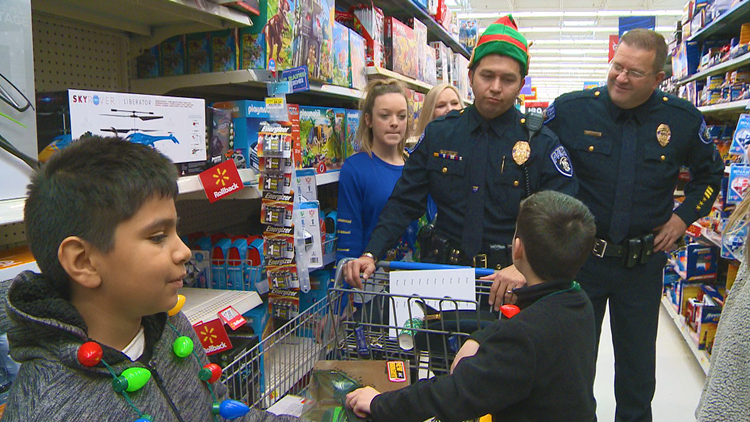 'Shop with a Cop' builds trust and brightens the holiday season in North Little Rock