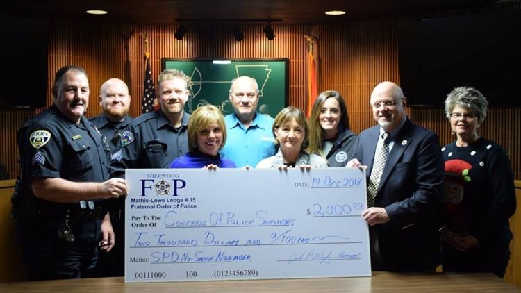 Sherwood Fraternal Order of Police donates $2K from No-Shave November funds