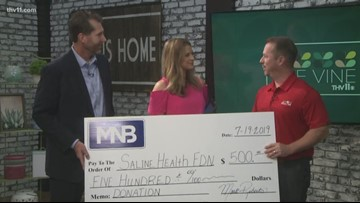 MNB Bank presents donation check to health-focused organization