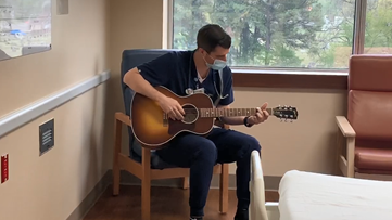 Watch: Saline County nurse sings to hospital staff and patient to ease COVID-19 tensions