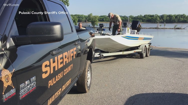 Officials investigating after body was found in Arkansas River
