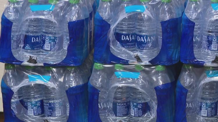 Coca-Cola donates bottles of water of Dunbar Middle School