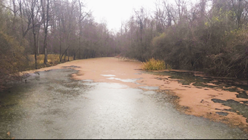What's turning parts of the Arkansas River red?