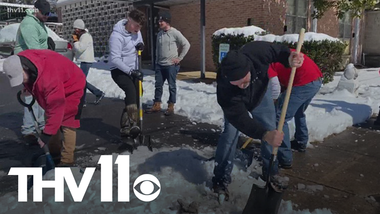 Volunteers clean up facility for the blind after winter weather storm