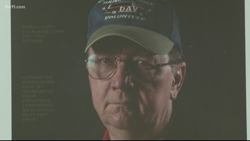 VA facilities line hallways with faces of veterans