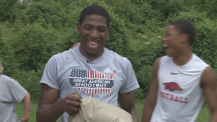NLR basketball helps community with flood preparations