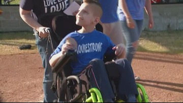 Louie throws first pitch for baseball team named after him