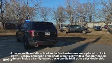 Jacksonville man barricaded himself inside used car dealership, nearby school placed on lockdown