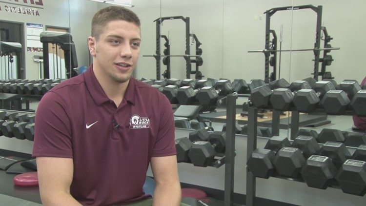 Bentonville native first Arkansan to wrestle for LR Trojans