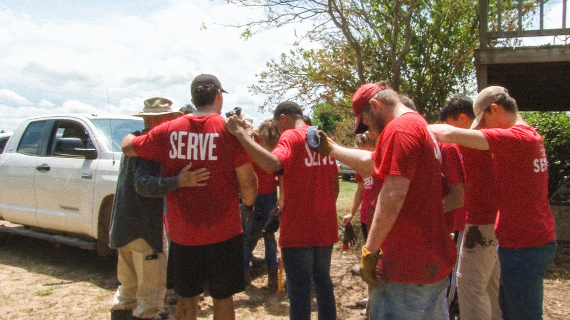 High schoolers spend their summer vacation lending a hand to flood victims