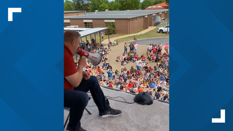 Elementary principal camps on school roof to celebrate students reading 50 million words