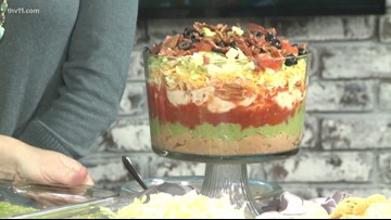 Deanna shows us how to make a seven-layer dip perfect for Super Bowl parties!