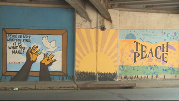 Artist expands peace and civil rights mural in Little Rock on 7th Street