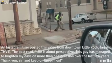 Worker dances with leaf blower in downtown Little Rock, brightens day of citizens