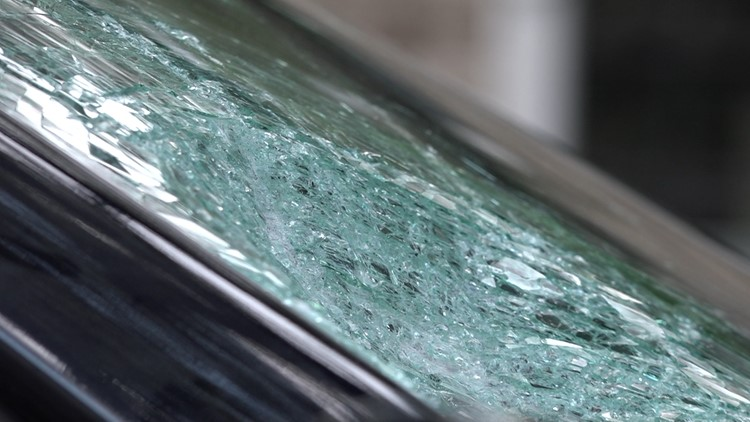 Car window smashed with concrete