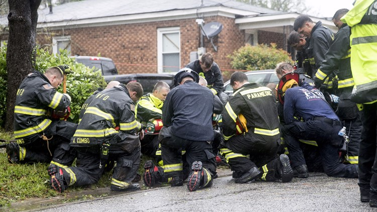 firefighters pray at tree resized_1536966209636.jpg.jpg