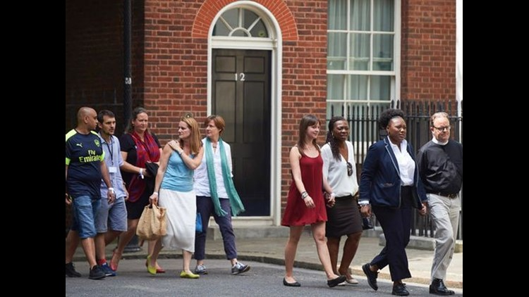 People, involved in the June 14 Grenfell Tower block fire, arrive at 10 Downing Street in central London on June 14, 2017.
