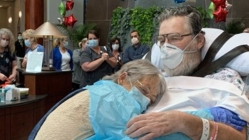 COVID-19 patient reunited with wife after 53 days