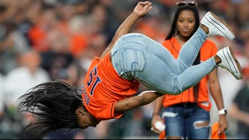 Simone Biles didn't just throw the 1st pitch of Game 2 of the World Series -- she flipped and twisted, too