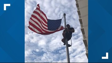 Navy SEAL climbs pole to fix American flag at Oceanfront monument